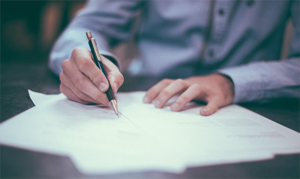 Person signing document.
